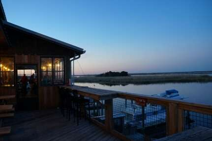 a view of the Up The Creek Raw Bar at dawn