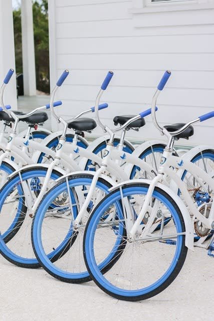 Blue and white rental bikes from the Bike Shop Alys Beach