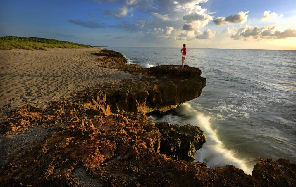 Blowing Rocks Preserve, girl on outcropping