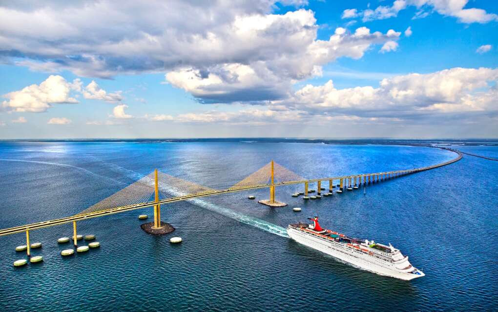 Carnival Paradise passes under the Sunshine Skyway Bridge as it leaves port on Tampa Bay.