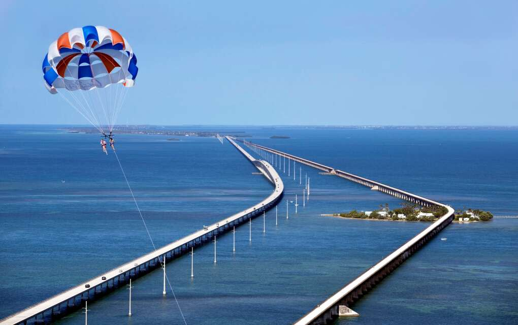 Ellie Cote and Christine Shelburn fly high above the Seven Mile Bridge in a parasail oprerated by Capt. Pip's Marina and Hideaway in Marathon, Fla.