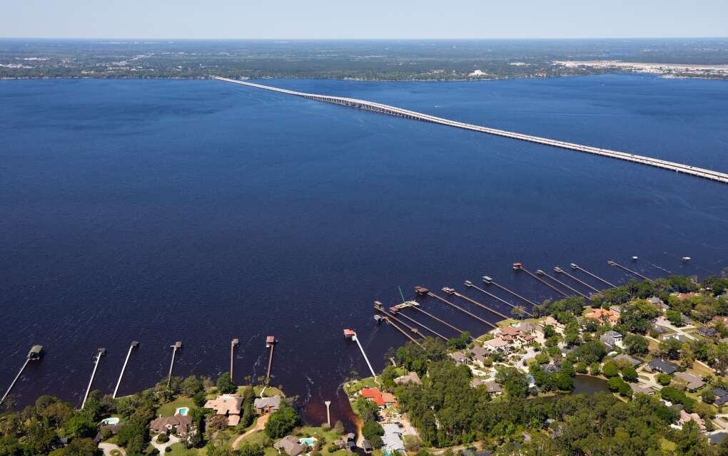 The Buckman Bridge in Jacksonville, Fla., aerial view including a lot of boat houses