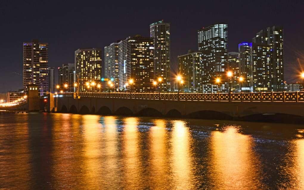 Venetian Causeway / Miami, lit-up bridge and city at night