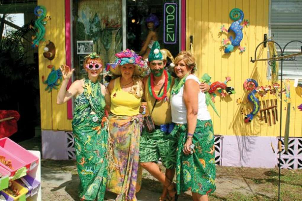 People at the Gecko festival having fun and posing for a photograph