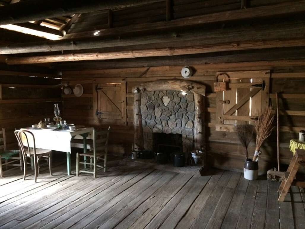 Interiors with fire place of the wood cottage in Holmes County