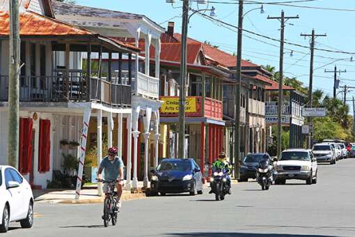 Bicycles, motorcycles and golf carts are some of the alternative ways to ride around historic parts of Cedar Key, like here along the historic Second Street looking east.