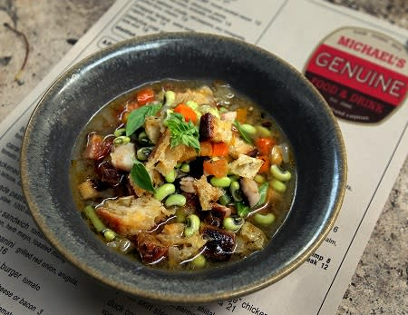 A bowl of soup with fresh vegetables from farm to table