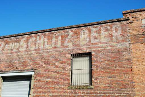 Schlitz Beer is painted on the brick wall near the Engine 15 production brewery