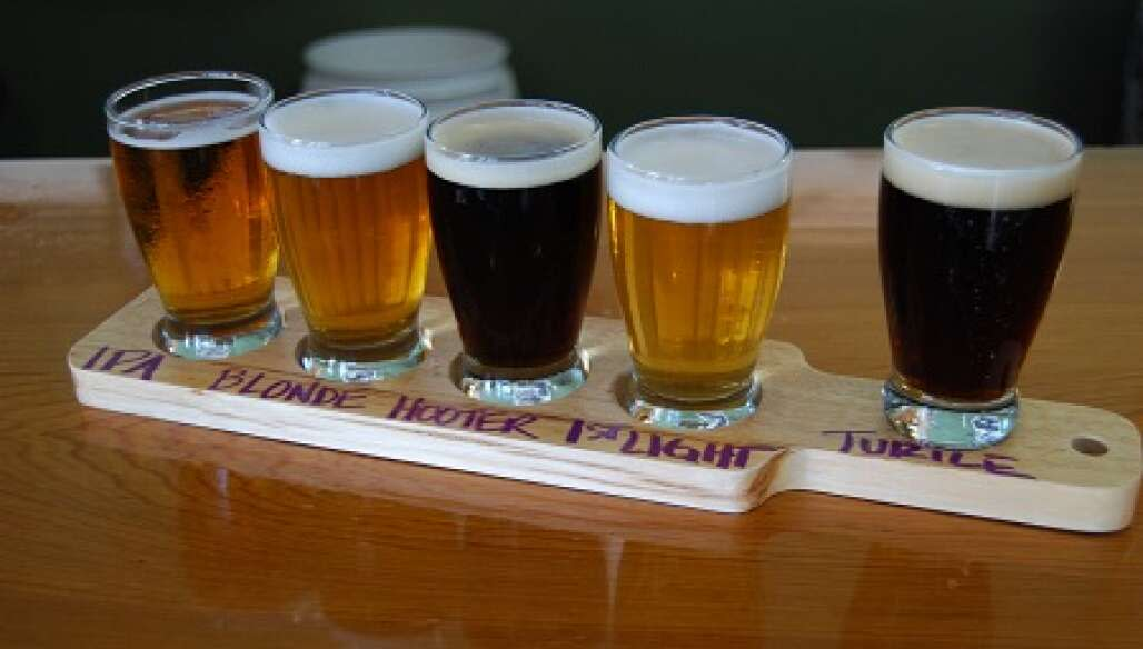 Several beer samples served on a platter at Oyster City Brewing