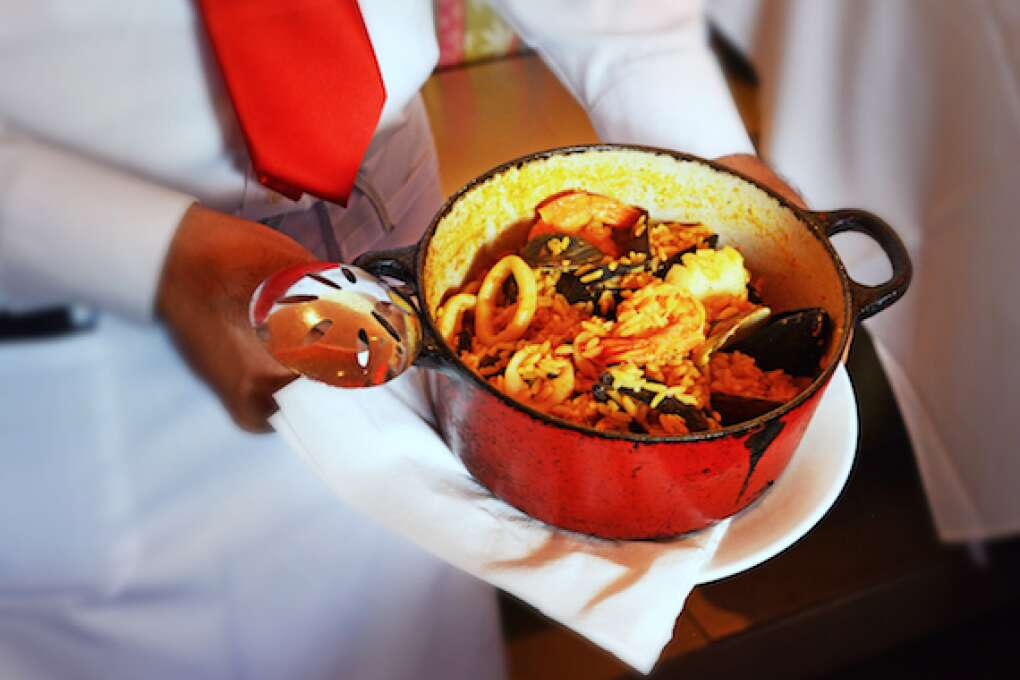 Paella marinera is a delectable dish made of shrimp, octopus, calamari, scallops, clams and mussels simmered with saffron and garlic in a caldera of valencia rice. 24.95 (with lobster tail) add 12.95 at Cabana El Rey. Photo by Peter W. Cross
