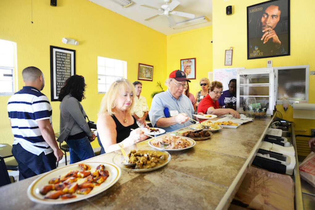 The food tour lines up for Jamaican dishes at Sweet's Sensational Jamaican Cafe in Delray Beach.