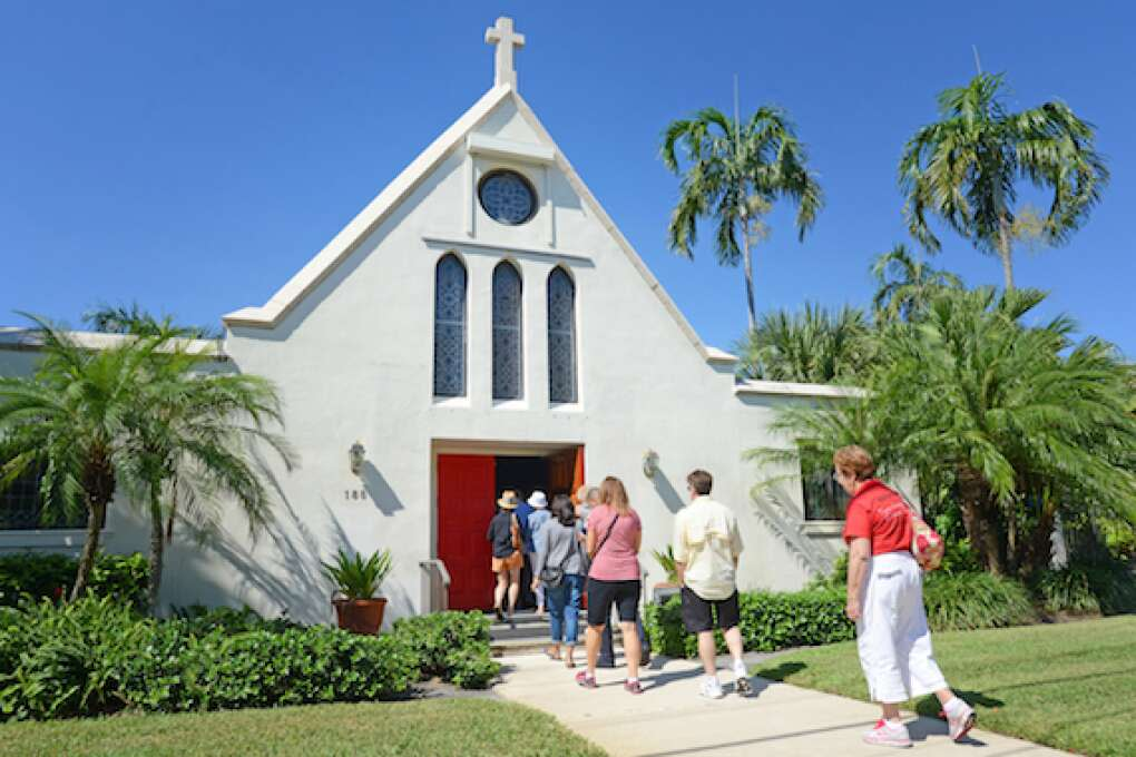 Much of the food tour is about local history. Here, the group visits St. Paul's Episcopal Church. The  Episcopal mission was built in 1904 on land where St Paul's Episcopal Church now stands. In 1919, St Paul's Episcopal Church became an Organized Mission and made its first report to the Diocese of South Florida. The new mission's church was leveled by the 1928 hurricane that ravaged the area, but the congregation persevered and the church was rebuilt in 1929.