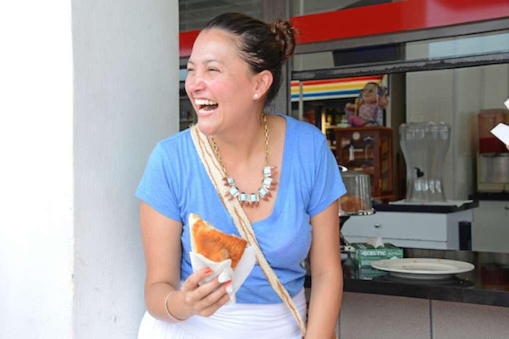 Tour guide Juanita De Castro entertains a group enjoying Cuban coffees and pastries outside, Abuela's, a traditional Cuban restaurant.