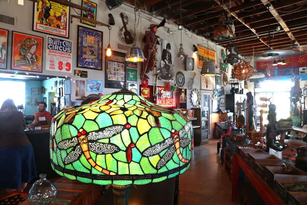 A display shows unique items, including a Tiffany-style lamp, at Circus City Architectural Salvage in Sarasota.