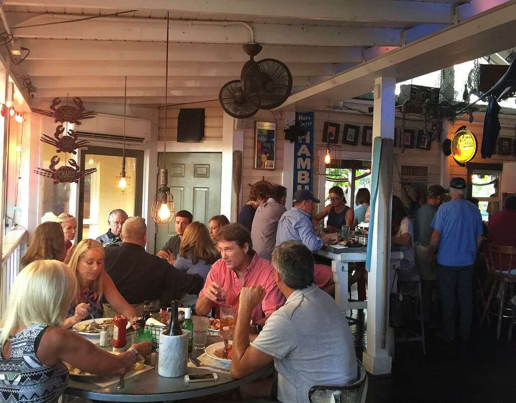 Diners enjoy dinner at Owen's Fish Camp in Sarasota. The business serves mostly local seafood updating Southern classics.