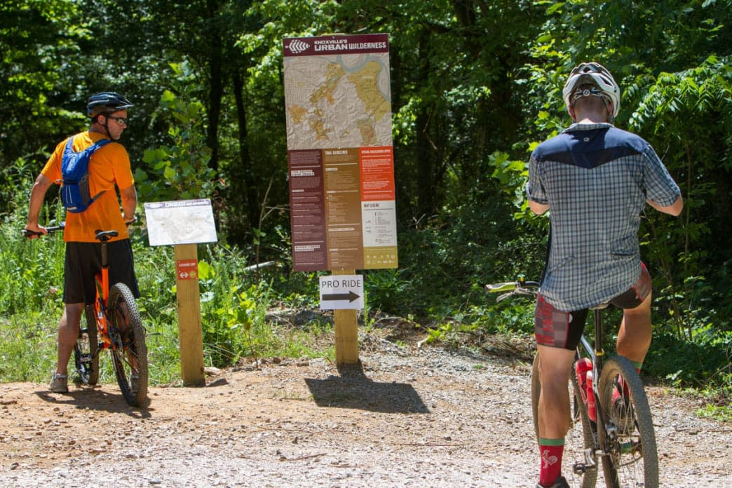 Mountain Bikers at trail head map on Baker Creek Preserve in Knoxville