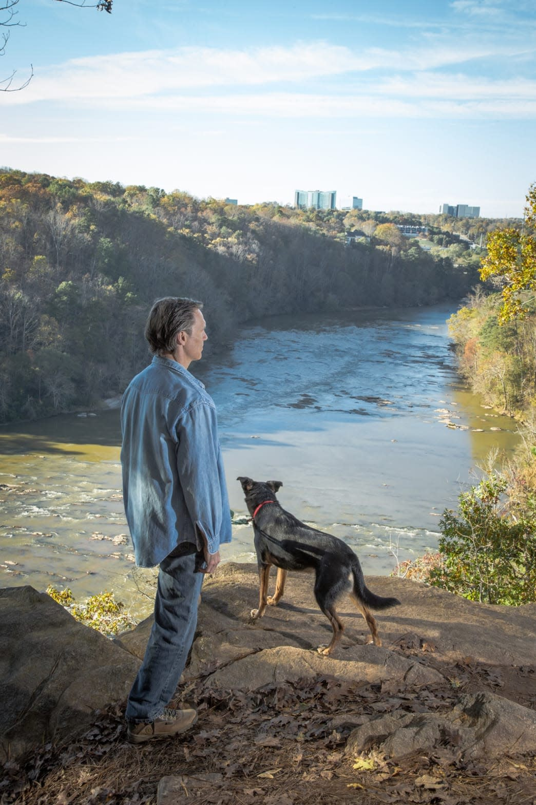 Man And Dog Overlooking The Chattahoochee River