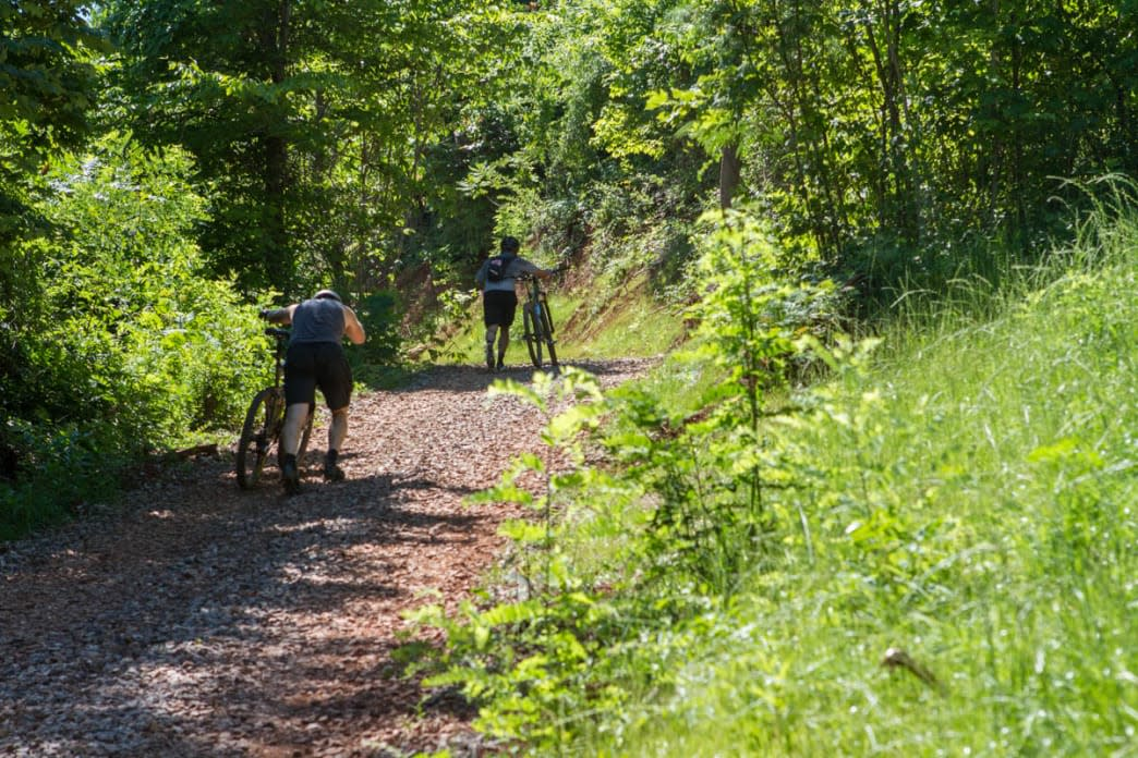 Mountain bikers walking up to Devil's Racetrack at Baker Creek Preserve in Knoxville
