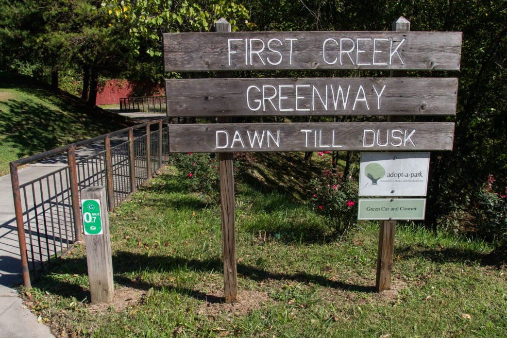 A sign on N. Broadway marks the north entrance to First Creek Greenway. 