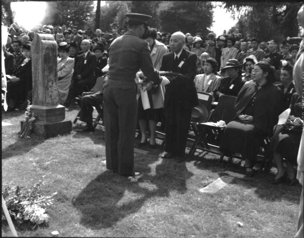 Shinichi Seike, father of Toll Seike, is seen at his son's memorial service on Sept. 25, 1948, at the Veterans Memorial Cemetery in Seattle.  (Wing Luke Museum)