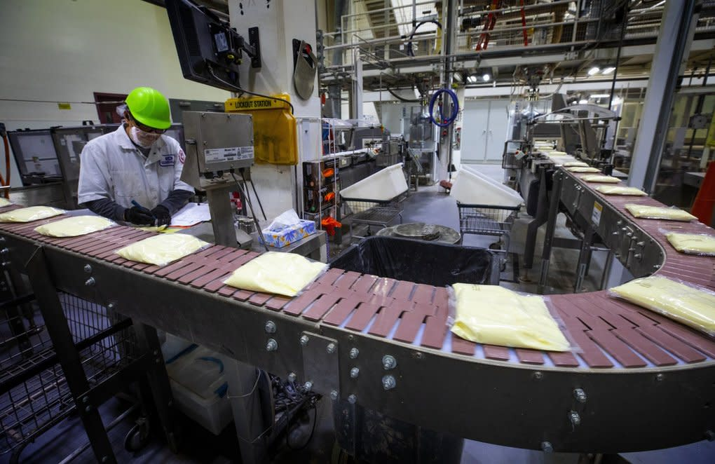 Gil Hernandez, packaging operator at Continental Mills in Kent, sets up equipment on the Krusteaz lemon-bar assembly line at the Krusteaz manufacturing plant in Kent last month. (Ellen M. Banner / The Seattle Times)