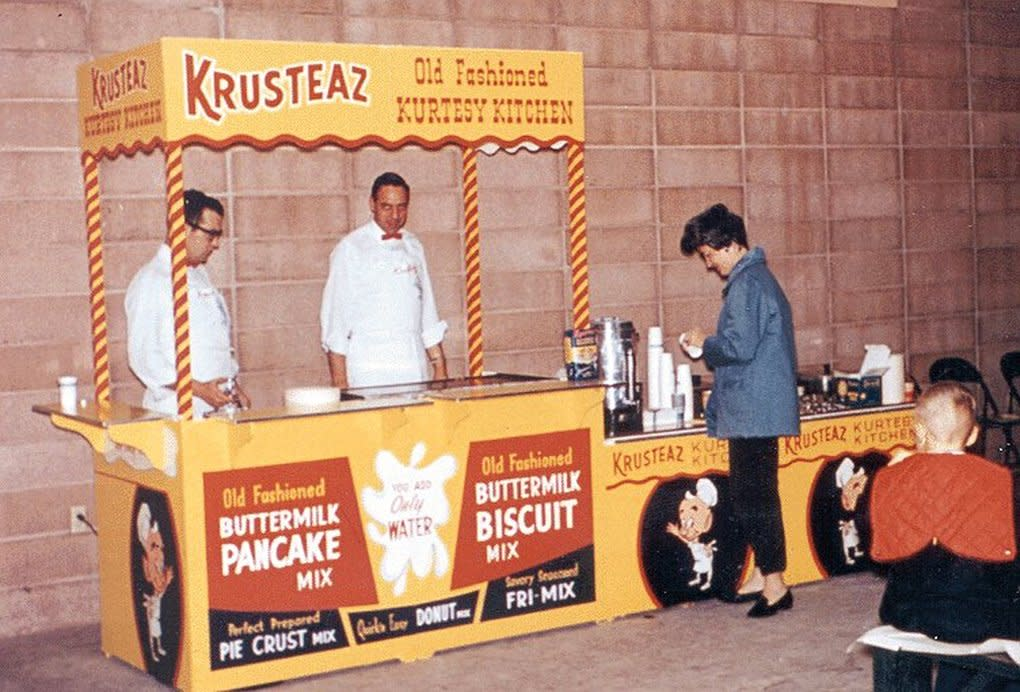 """The """"Old Fashioned Kurtesy Kitchen"""" was a booth that served coffee and pancakes to grocery store customers. (Courtesy of Krusteaz / Continental Mills)"""