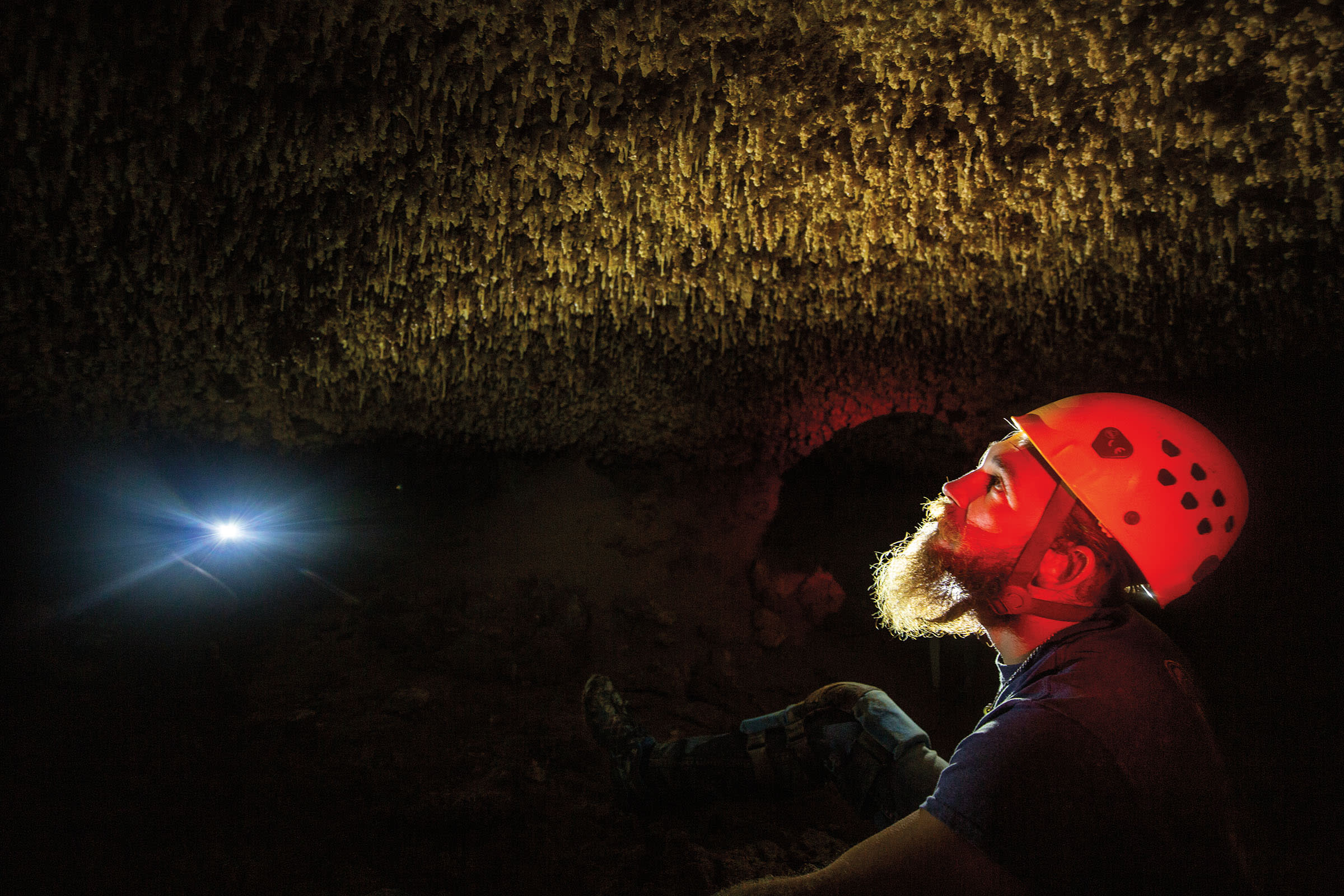 Colton Moore eyes speleothems in the Caverns of Sonora