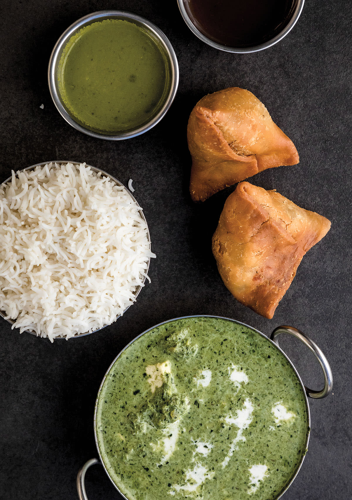 An overhead view of various Indian dishes