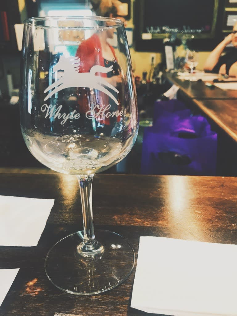 Photo of a glass at the tasting counter at Whyte Horse Winery.