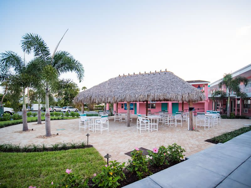 """A new coat of retro """"Florida pink"""" and a tiki hut are the latest additions to the Caribbean Shores Waterfront Resort in Jensen Beach, Florida. Courtesy of Caribbean Shores Waterfront Resort"""