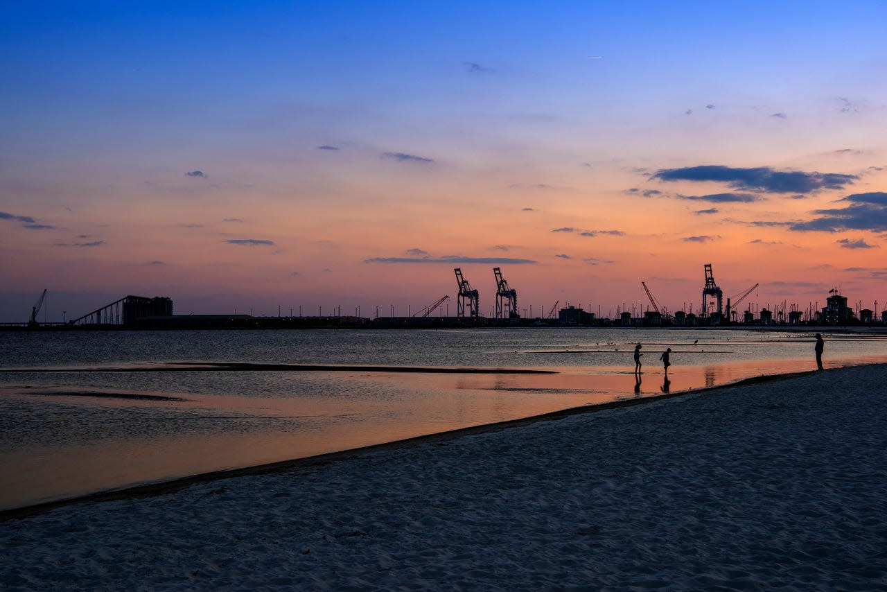 Silhouettes of shipping cranes in Gulfport Harbor are steady reminders of the Mississippi Gulf Coast's maritime history. A dozen cities, including Gulfport, comprise Coastal Mississippi.