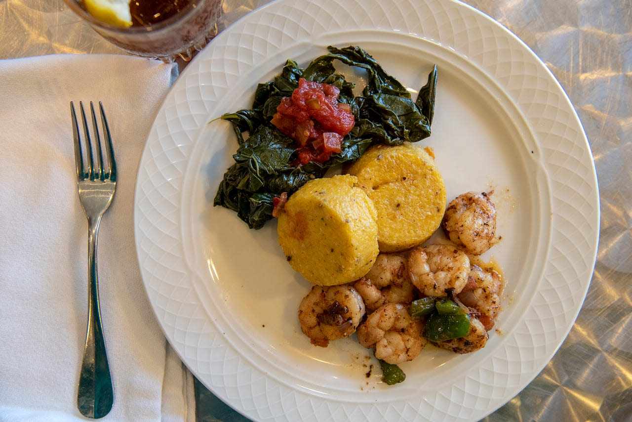 Julian Brunt's shrimp and grits, prepared at the Mary C. O'Keefe Cultural Center in Ocean Springs, includes local gulf shrimp cooked in butter and olive oil with green peppers, garlic and onions; seasoned collard greens topped with chow-chow; and The Original Grit Girl grits prepared with ham.