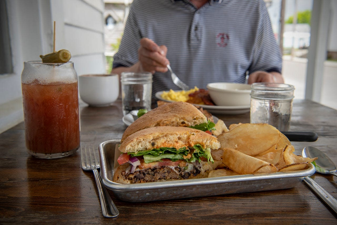 The front porch is a relaxing spot to enjoy Mockingbird Cafe's Summer Garden Burger and Bloody Mary.
