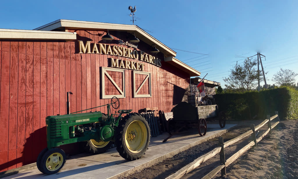 Tractor in front of Manassero Farms Market building in Irvine, CA