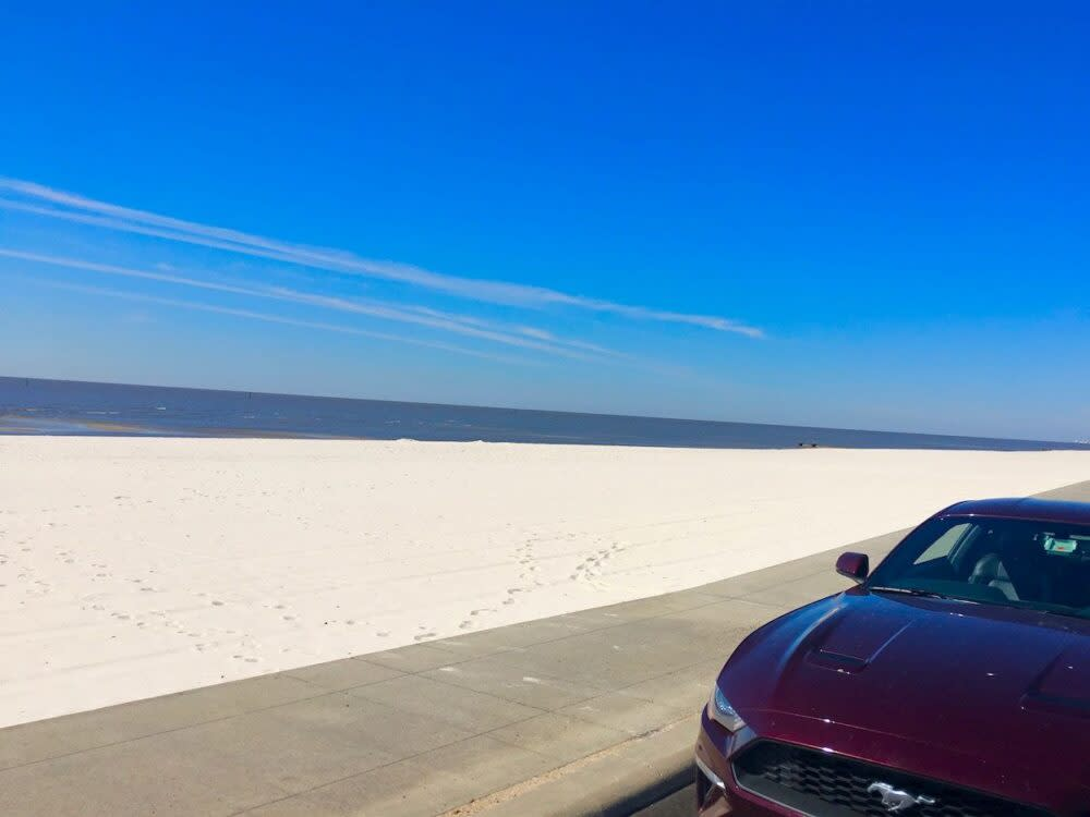 Best Day Trips from New Orleans | The Common Traveler | image: car along white sand beaches in Coastal Mississippi |New Orleans Day Trips by popular US travel blog, The Common Traveler: image of a white sand beach.