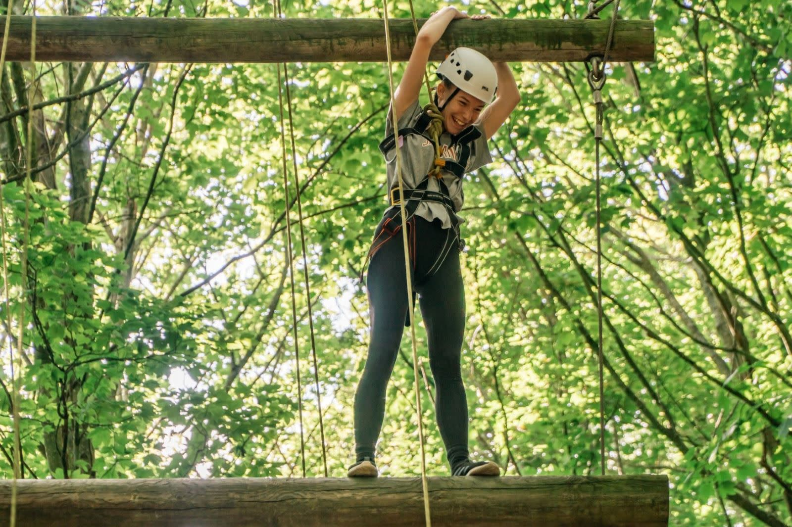 Kids on the High Ropes in a wooded area