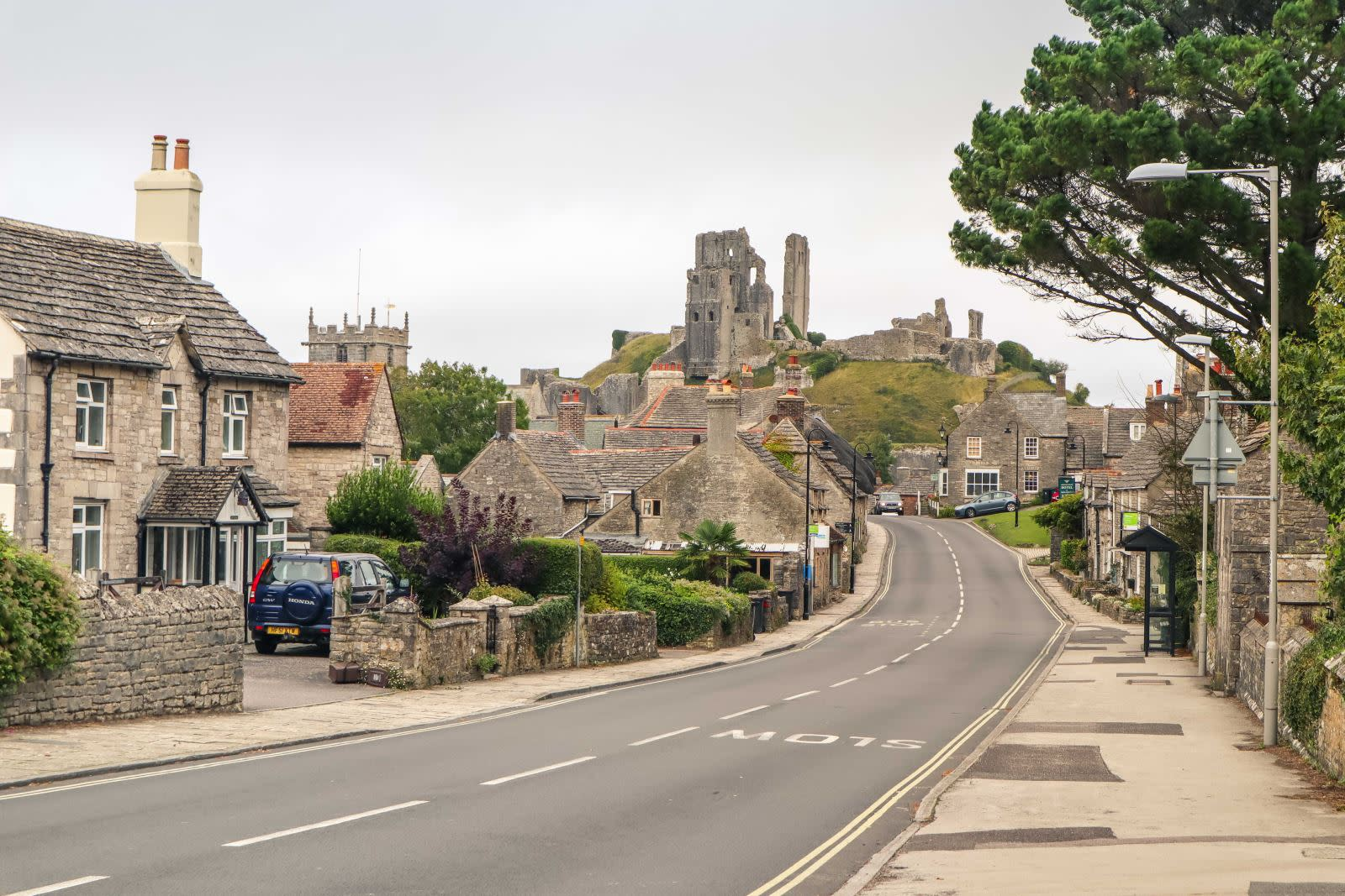 Corfe Village, with Corfe Castle in the background.