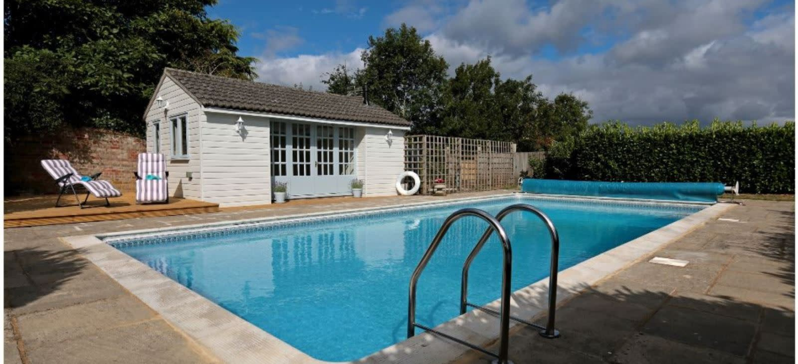 Outdoor swimming pool at Stable Cottage near Dorchester, Dorset