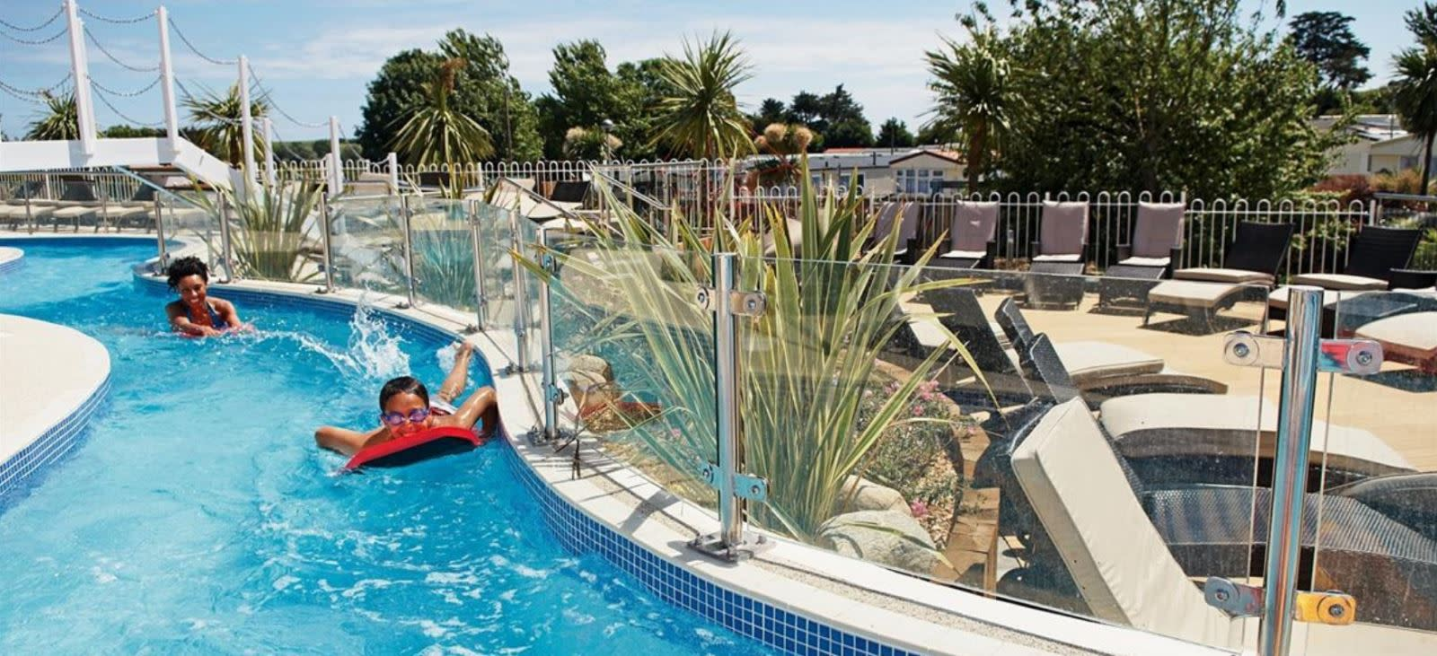 Outdoor swimming pool and Lazy River at Weymouth Bay Holiday Park, Dorset