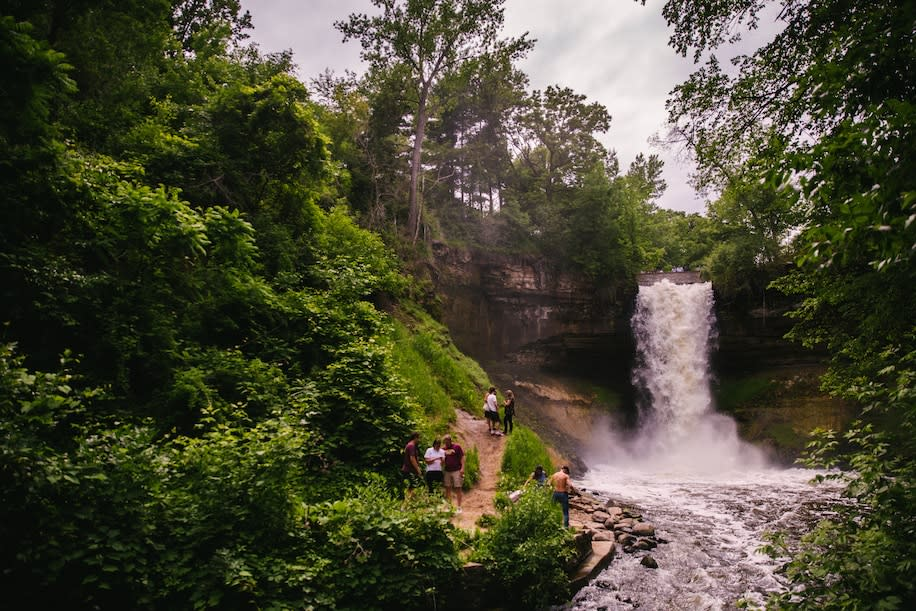 Visitors enjoy Minnehaha Falls in Minneapolis's Minnehaha Regional Park.