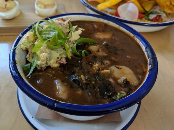 Hambone's thick, dark brown gumbo is packed with fresh Louisiana Gulf shrimp and seasoned with ham hocks and collard greens | WhereTraveler