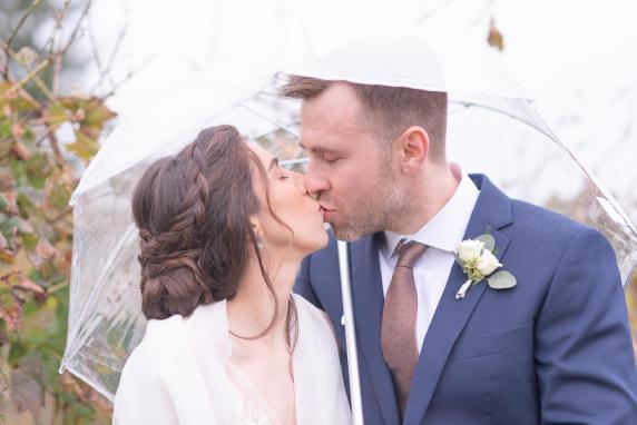 Kissing under an umbrella