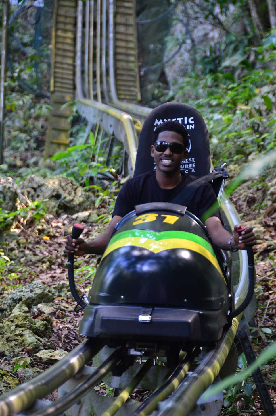 Man in bobsled at Mystic Mountain in Jamaica