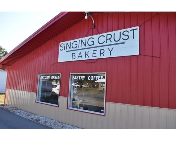 The Singing Crust Front of Building Clayton, IN