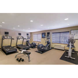 Fitness Center, free weights and TVs on each of the cardio equipment