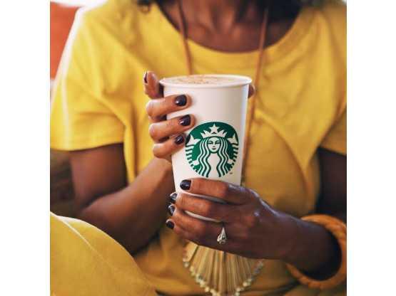 Starbucks Cafe, The Saratoga Hilton, woman in yellow shirt holding coffee