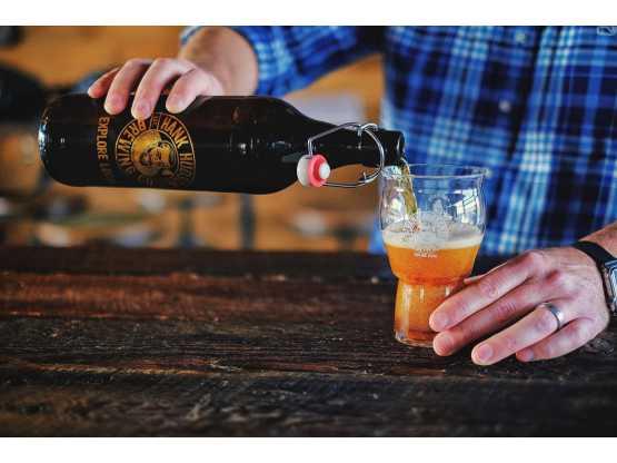 Hank Hudson Brewing bartender pouring beer