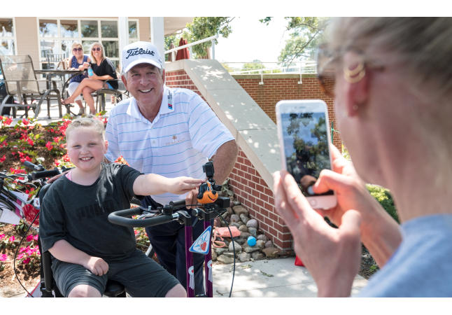 Jay Haas and young bike recipient at 2017 Principal Charity Classic