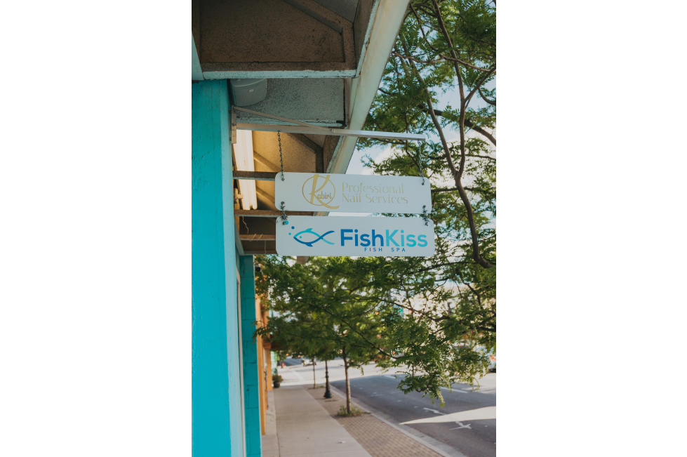 Fish Kiss Sign and Front of Building
