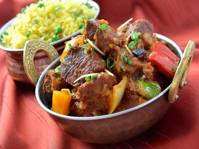 Clay Oven Express - Lamb Tikka Masala Tender boneless lamb cooked in a rich dark Masala sauce. (Gluten Free)